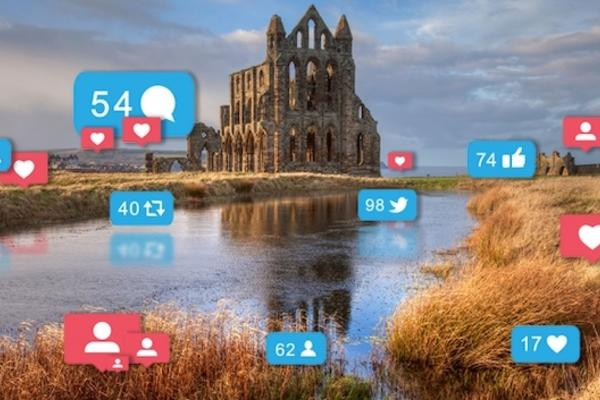 whitby abbey with social media icons 670x370